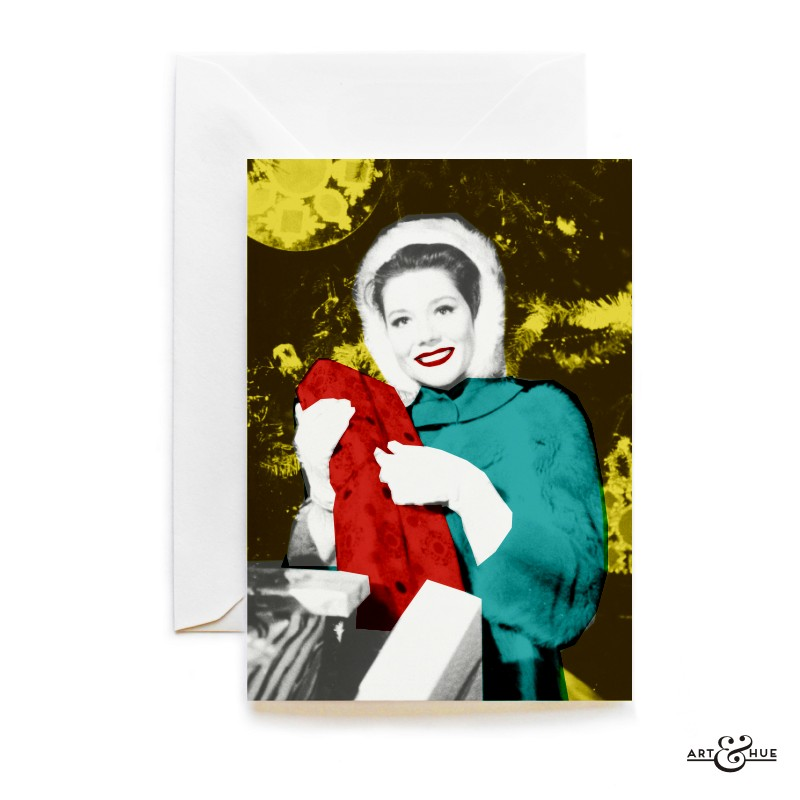 Merry Xmas with Emma Peel unwrapping a Christmas gift by Art & Hue